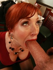 Redhead mature tries to suck very huge..