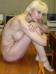 Blonde mature temptress takes naked..