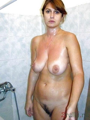 Middleaged mother undresses in locker room