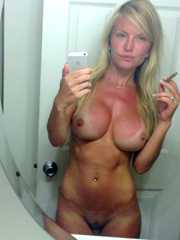 Busty amateur mom self-shot pictures in..