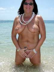 Funny nude granny with big beads on the..