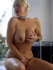 Blonde MILF rubs her amazing big tits..