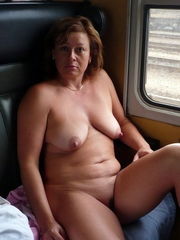 Absolutely nude older mom in train wagon