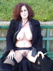 Curly mommy in black lingerie flashing..