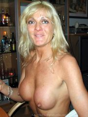 Naked Blonde MILF with fake silicone..