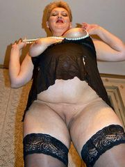 Mature BBW In a black corset and black..