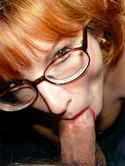 Redhead mature babe in glasses deeply..