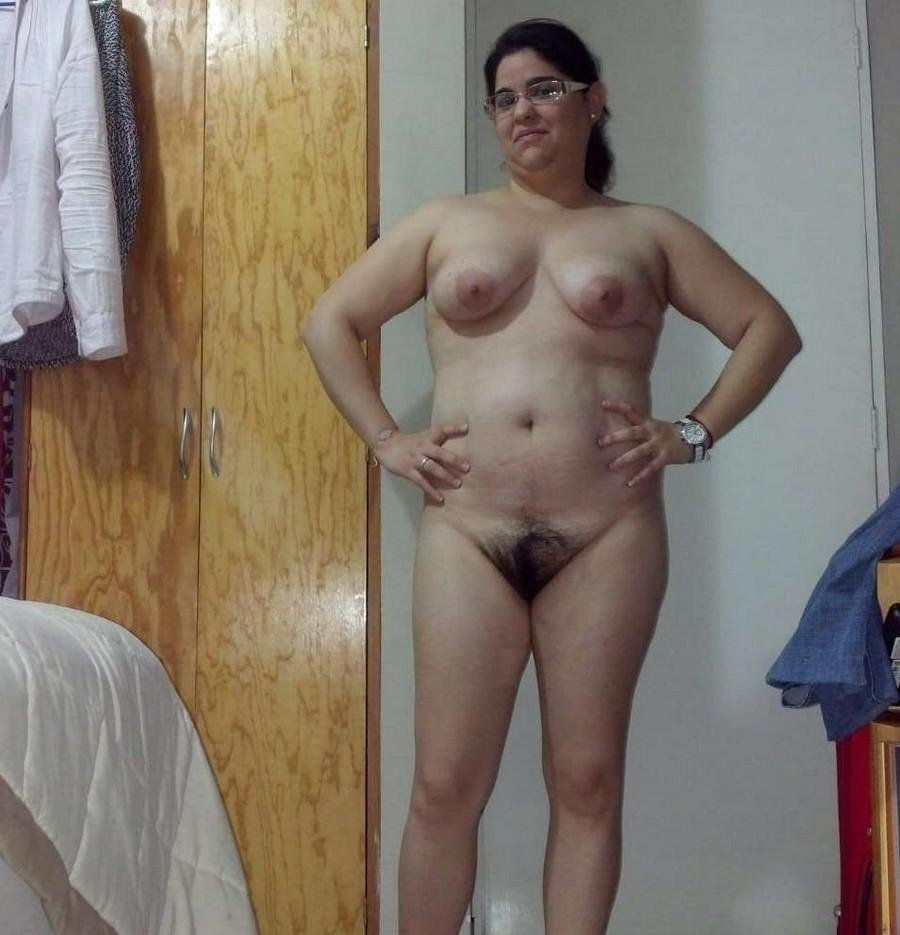 naked girl bent over wearing heels